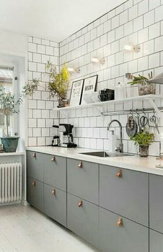 Grey and white kitchen with white square tile