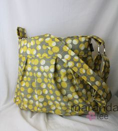 This is one of my favorite bags. Used it as a diaper bag when EJ was little and now use it as a larger purse when I need it. Even holds my laptop. (by Maranda Lee)