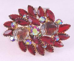 Check out this item in my Etsy shop https://www.etsy.com/listing/232224051/siam-red-rhinestone-pin-vintage-red