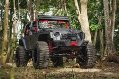 Lifted Jeep in the woods http://www.wheelhero.com/topics/Jeep-Wheels-For-Sale