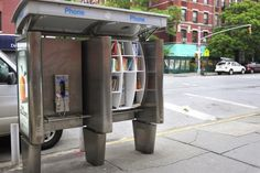 """New York sees a few of its old phone booths turned into libraries in a project by John Locke, an architecture grad from Colombia. Says Locke, """"What more can you say about books? John Locke, Mini Library, Little Library, Little Free Libraries, Gravity Falls, New York, Old Phone, Eiffel, Guerrilla"""