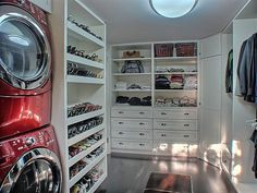 The laundry room/walk in closet in our old house.. I miss my shoe wall and my ruby red washer/dryer!
