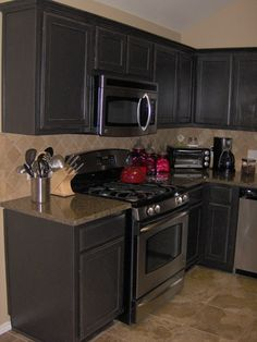 Image detail for -Distressed Black Kitchen Cabinets. Love the countertops too.