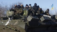 Hundreds of exhausted Ukrainian forces staged a chaotic retreat Wednesday from a strategic town besieged by pro-Russian rebels, marking a major defeat for the government and bringing uncertain consequences to efforts at ending the 10-month-old conflict.  The scenes from the railway hub Debaltseve — with Ukrainian soldiers facing fire even as they withdrew over frozen fields — were a stunning reminder of the region's instability less than a week after the announcement of another cease-fire…