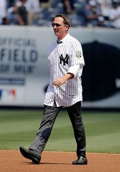 David Cone walks onto the field during the ceremony before the game at Yankee…