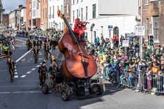 Bui Bolg Giant Fiddle Float in St Patrick's day Parade St Patricks Day Parade, Jazz Festival, Community Events, 40th Anniversary, Street Art, Image