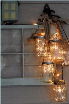 Just when you thought you'd seen every brilliant mason jar craft, here;s Moon Over Mason Jar Light. This spectacular craft combines many mason jars into one stunning chandelier and teaches you how to make a lantern. Mason Jar Projects, Mason Jar Crafts, Mason Jar Diy, Mason Jar Lamp, Jar Candle, Mason Jar Storage, Candle Holders, Diy Mason Jar Lights, Mason Jar Light Fixture