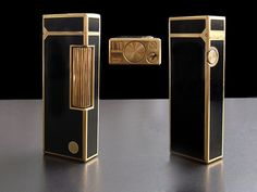 Vintage Black Lacquer Rollagas Dunhill Lighter: A very nice Rollagas Dunhill  lighter with black lacquer panels and Gold plated surround. Circular Dunhill motif on the front.Swiss made and in full working order. ---- INV.No119-572 -- £195.00