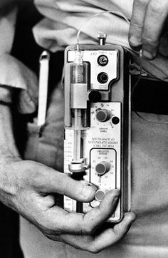 Associated Press reporter Patrick Connolly, in Seattle, Wa., Dec. 18, 1986, adjusts the insulin pump he wears on his belt to keep his blood sugar near normal.  Connolly, who has had diabetes for 27 years, receives a squirt of insulin through a slim tube into a small needle under the skin of his abdomen every few minutes from the one-pound pump.