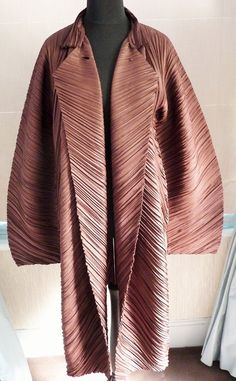 Issey Miyake main collection brown deep accordion pleated coat showing lapels