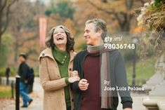 Arms linked, walking and laughing - older/middle aged couple photo idea