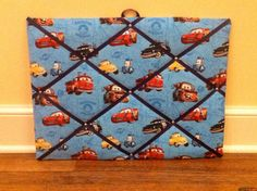 Disney Cars memory board - I wonder if my sister could help me make something similar?