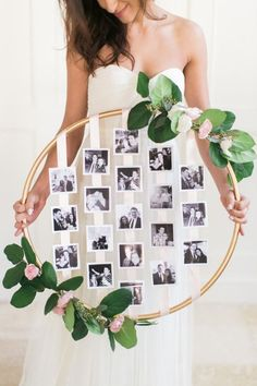 Make a stunning photo display with a hula hoop! The perfect bridal shower DIY.