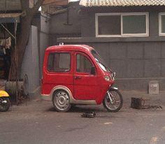 Red three-wheeler