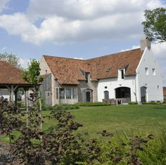 Note that the facade on the right protrudes the roof line with the brick capped chimney, very dutch. New Urbanism, Dutch House, Stucco Homes, Villa, Belgian Style, Home On The Range, Classic House, House Goals, The Ranch