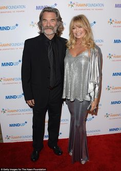 Happily unmarried: Goldie Hawn steps out with Kurt Russell... her domestic partner and leading man of 32 years  'My amazing wild and awesome man': Goldie recently paid tribute to Kurt with a touching message she posted to Twitter as he celebrated his 64th birthday on March 17