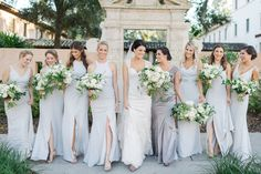 bride and her maids in pale grey gowns hold loose and organic all white bouquets of roses, ranunculus, veronica, anemone, tulips, variegated greenery and vines. Cheap Bridesmaid Dresses, Wedding Dresses, Grey Gown, Event Services, How To Make Shoes, Rose Bouquet, Dusty Blue, Dress Backs, Shoulder Dress