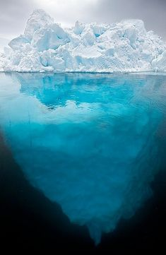 bluepueblo: Via tumblr  Split-View Iceberg, Greenland photo via besttravelphotos
