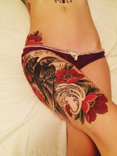 Upper leg tattoo -love placement!!! don't care for the flowers but I do love the raven with some color behind it