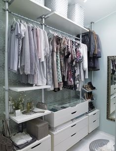 walk in closet STOLMEN van IKEA. This is the first time I've seen this Ikea closet system installed in a closet with a sloped ceiling. Ikea Shoe, Ikea Closet, Wardrobe Closet, Closet Space, Elvarli Ikea, Stolmen Ikea, Closets Pequenos, Walk In Closet Inspiration, Master Bedroom Closet