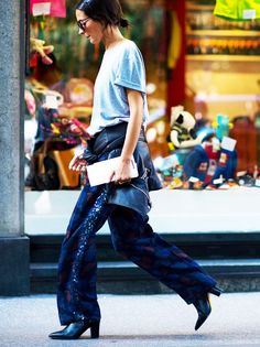 A basic t-shirt pairs well with printed trousers, a moto jacket, and easy black boots