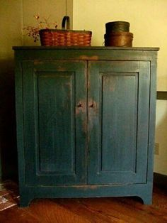 This for the dresser.The above cabinet may look blue, but it's actually black paint over brown stain and antiqued to simulate age and wear. Nice wear-- Old Colony Primitives Primitive Cabinets, Primitive Furniture, Primitive Antiques, Country Furniture, Antique Furniture, Painted Furniture, Primitive Country, Distressed Furniture, Prim Decor