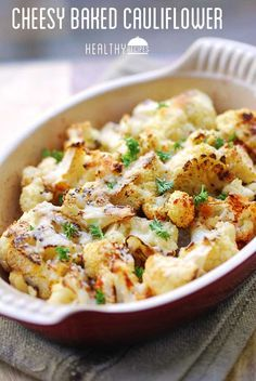 Cheesy Baked Cauliflower: Cauliflower florets are tossed in olive oil and garlic, baked until just tender, then topped with Parmesan and baked until golden brown.