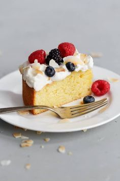 EASY Lemon Coconut Cake topped with lightly sweetened whipped cream and fresh mixed berries. This simple celebration cake for spring is elegant, flavorful, and comes together quickly. #lemon #coconut #cake #desserts #abeautifulplate #berries