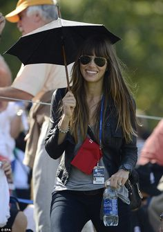 That's what you call a cheerleader: Jessica Biel cheered on her man Justin at the golf