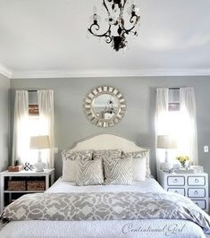 """I like the """"mismatching"""" nightstands, and we have that duvet at the bottom of the bed."""