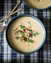 "Creamy Parsnip Soup with Pear and Walnuts Recipe // ""I love that root vegetables are so rustic,"" says chef Marcus Samuelsson about this earthy, Indian-spiced soup."