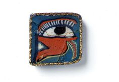"""Mosaic glass, 1st century B.C.E./C.E.  These rectangular decorative plaques show images of eye, depicted in purple, white, red, yellow, blue, green and cobalt glass on grounds of turquoise, blue and black glass. The wedjat means """"cured"""" and is the sacred left eye of the god of the heavens Horus. His left eye symbolized the moon while his right eye the sun. Horus is shown with a falcon's head, and this eye form, a human eye and a falcon's face were often combined as motifs. Horus's left eye…"""