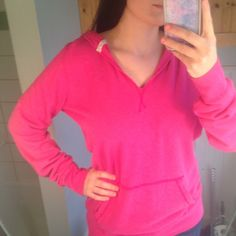 Victoria's Secret pink sweatshirt V neck Victoria's Secret PINK sweatshirt. Thinner than a sweatshirt. Size medium but I'm a small and it fits me well too (shown in the 1st picture) very good condition PINK Victoria's Secret Tops Sweatshirts & Hoodies