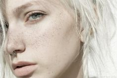 small horseshoe type shape (circular barbell) jewellery in septum piercing and white hair with random braid/ plait