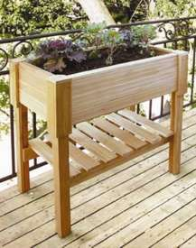 Planter with shelf