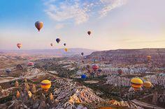cappadocia-turkey-hot-air-balloons-flying-gettyimages_166186583