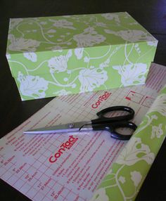 Cover shoe boxes with contact paper for decorative yet inexpensive storage.