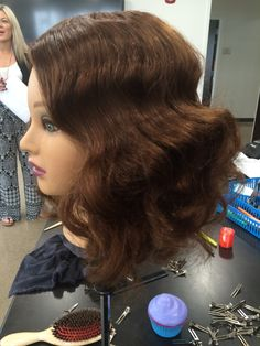 Pin curls brushed and styled