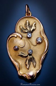 A Very Fine Art Nouveau Antique Russian Jeweled Gold Pendant Locket made in Moscow between 1899 and 1908  56 zolotniks gold standard (14K-583), two white, one champagne, and one cognac-brown antique cut brilliant diamonds