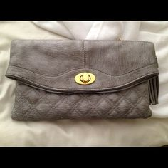 Grey clutch Grey clutch.  Comes with strap. Can be worn multiple ways. Excellent condition. Faux leather material urban expressions Bags Clutches & Wristlets