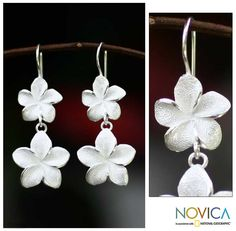 I've seen a lot of plumeria earrings lately, but these are the first I have seen with such an interesting texture.  These double-drops are very classy.  Trivia: According to some, each petal of a frangipani/plumeria has a  different meaning: sincerity, faith, aspiration, devotion, and surrender.