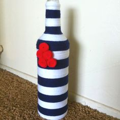 Yarn covered bottle with felt flowers.