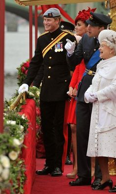 The Royal family at the Jubilee river pageant.  (Hello, Harry!)