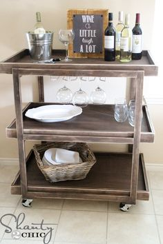 DIY Bar Cart: Crate and Barrel makes a similar one for $800. This knock-off can be made for about $150 including the hardware.