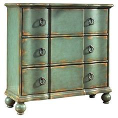 "color for island    Product: ChestConstruction Material: Hardwood and wood veneersColor: Weathered green Features: Ring-pull hardwareThree drawers Bun feetDimensions: 35"" H x 34"" W x 13"" D"