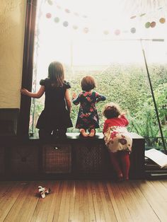 I saw this pic and my instant interpretation of photo: me (far left), kelley (middle).... Cece (munchkin having a struggle getting on to the ole window sill). Miss you Kel! @Kelley Stevenson