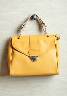 Winston Classic Mustard Purse  42.99 at shopruche.com. This faux leather tote purse in mustard is fashioned with golden hardware and an optional shoulder strap in tan. Finished with a zipper closure and a spacious interior compartment with side pockets.  10.75'' L x 9.5''H x 3.5'' W , 4.5'' strap drop , 1 inner zipper closure , 2 inner compartments