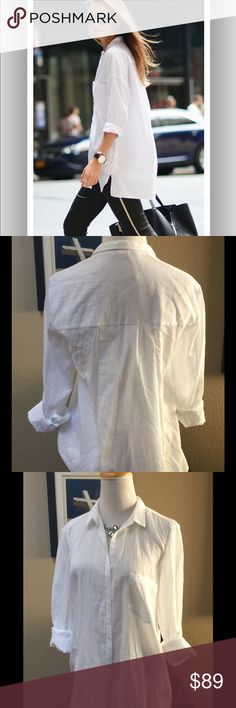 """HELMUT LANG BLOUSE Beautifully made and very comfortable white poet type button down blouse with left breast pocket. 100% cotton. Can be worn with numerous outfits and in many ways. Measures 29"""" in front, back measurements from collar to hem 31"""". Excellent condition. Helmut Lang Tops Button Down Shirts"""