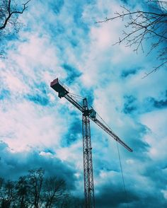 #Crane with a #blue and #cloudy #sky #background
