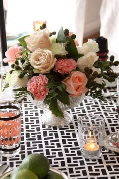 lovely table setting...pretty pink with black & white!